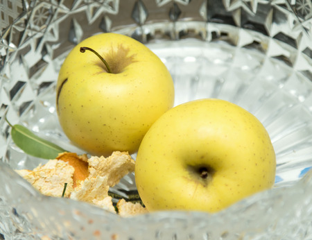 crystal bowl: Two green apples in a crystal bowl