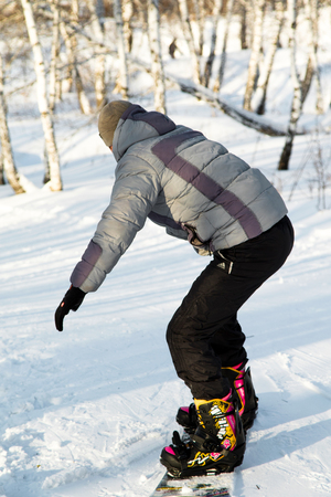 ski traces: PETROPAVLOVSK, KAZAKHSTAN- JANUARY 24, 2016: Snowboard ride from the mountain in a forest in a recreation center in Kazakhstan Editorial