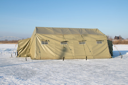tarpaulin: Canvas military tents, winter Stock Photo