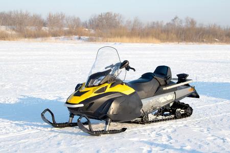 A snowmobile in a winter  landscape Imagens