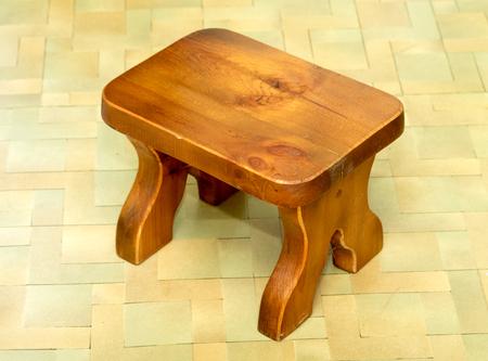 stool: wooden stool on the floor