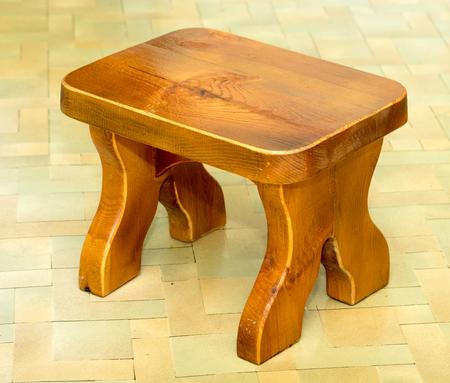 wooden stool on the floor
