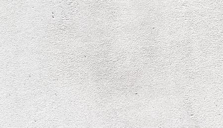 pared rota: cemento de yeso de la pared fondo blanco Foto de archivo