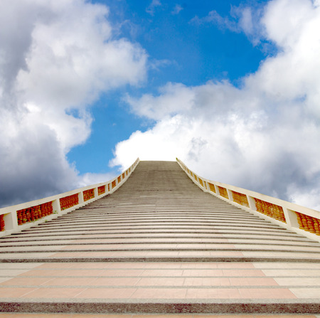 paradox: concrete staircase going up into a blue sky