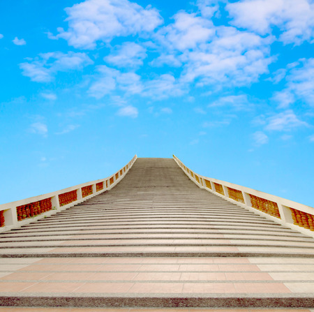 spiritual journey: concrete staircase going up into a blue sky