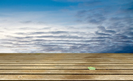wood abandoned: Cloudy blue sky and wood floor, background image.