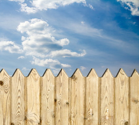 picket green: wooden fence   on sky background