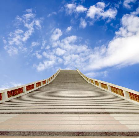 stonemason: concrete staircase going up into a blue sky