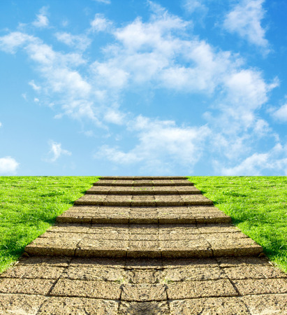 sunny day: stone steps on the grass in the sky clouds