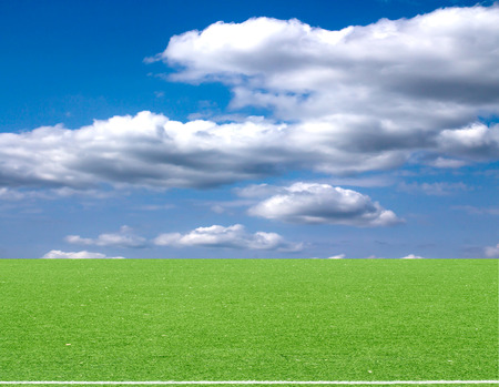 brig: football field blue sky with clouds Stock Photo