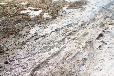 inclement: dirt on a snowy road Stock Photo