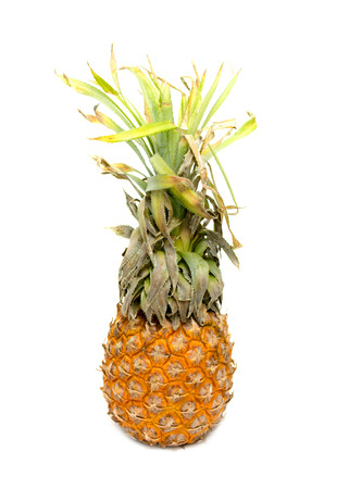 fruit and veg: ripe pineapple close-up on a white background