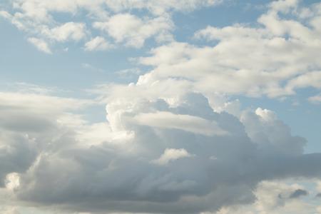 the medium: Cloudy cumulus, medium, high in the blue sky background