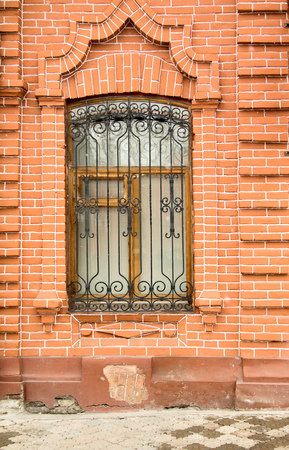 lattice window: with lattice window old house red brick