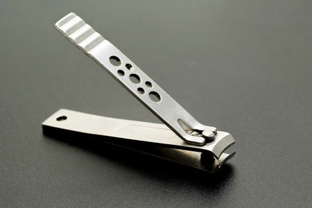 nail clippers: nail clippers on dark background