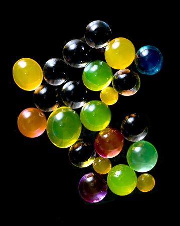 limpid: hydrogel colored balls on black Stock Photo