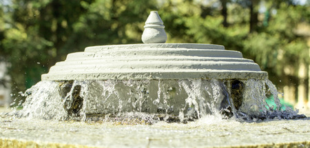 beauty fountain: small fountain in the park, spring landscape