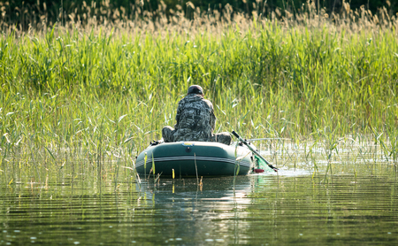 catch fish: fishermen catch fish with a rubber boat Stock Photo