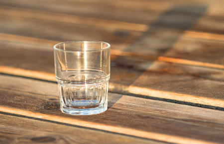 empty glass: empty glass  standing on the wooden table Stock Photo