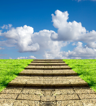 stone steps on the grass in the sky clouds