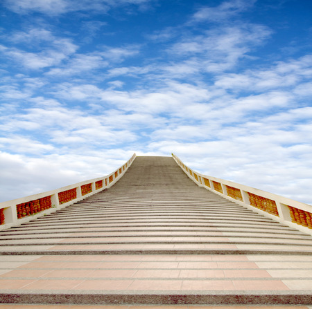 concrete staircase going up into a blue sky