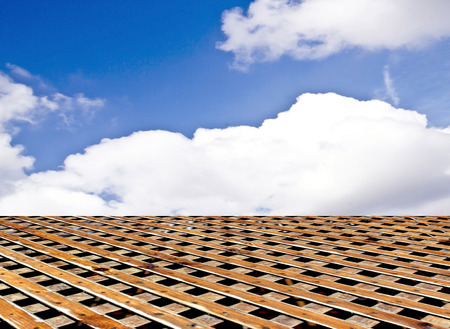 wooden floor blue sky with clouds Stock Photo