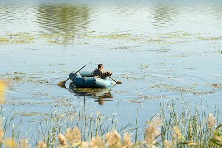 fisherman in a rubber boat, fishing
