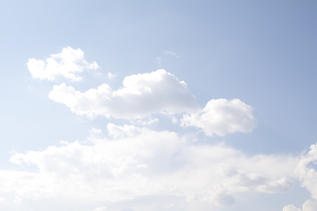 White cumulus clouds against the blue sky Stock Photo