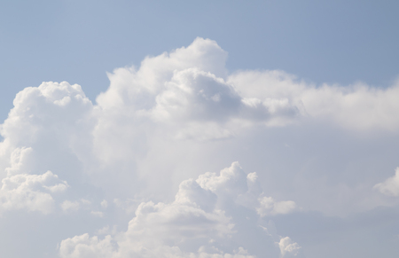 cumulus: White cumulus clouds against the blue sky Stock Photo