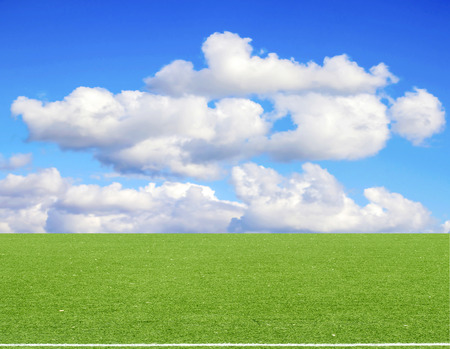 football field blue sky with clouds Stock Photo