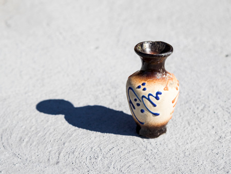 earthenware: old ancient earthenware jar with a list
