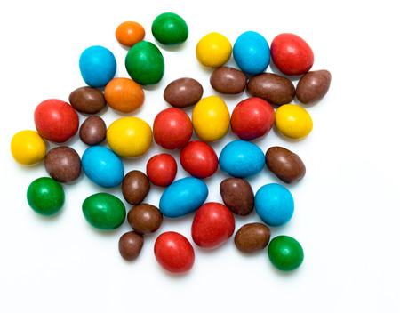 round colored candy on white background Stock Photo
