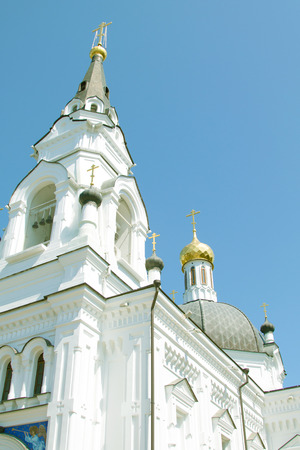 White Orthodox church with golden domes