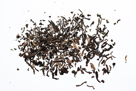 Black tea loose dry on a white background