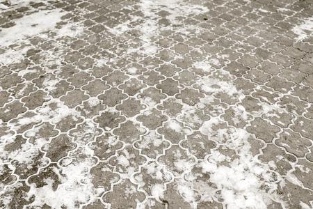 snow on asphalt road