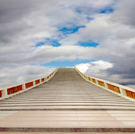 a mirage: concrete staircase going up into a blue sky