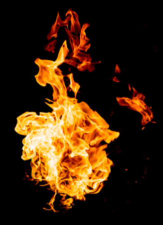 igniting: red yellow flames on black background Stock Photo