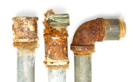 rusty metal pipe on a white background Stock Photo