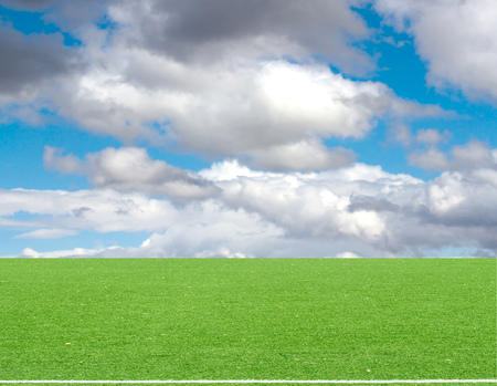 sun s: football field blue sky with clouds Stock Photo