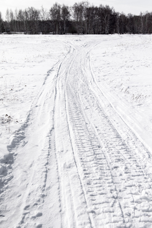 winter tires: road trail in the snow, winter