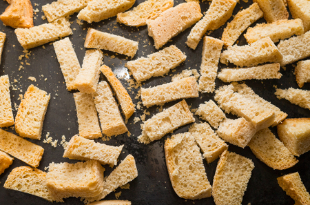 pieces of dried bread crumbs