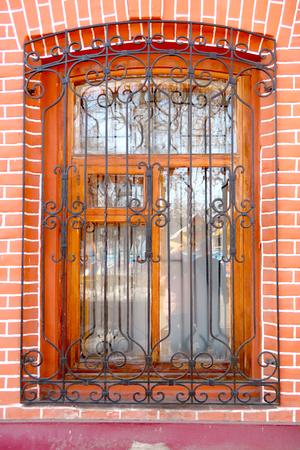 Window with lattices in a brick old house Stock Photo