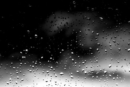 Raindrops on black glass