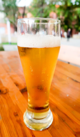 brewery: A glass of beer on the table in a summer cafe Stock Photo