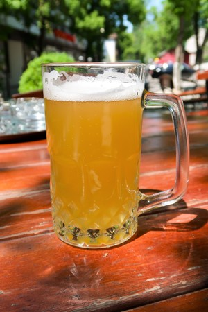 A beer mug in the summer bar on the table