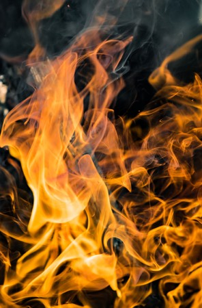 flammable: Flame of fire on a black background Stock Photo