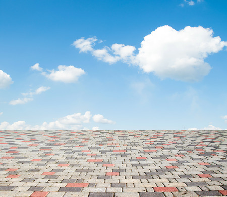 paving stones against the sky with clouds Stock Photo