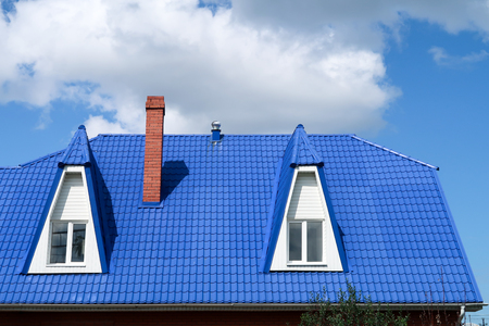Roof with blue tile windows, sky