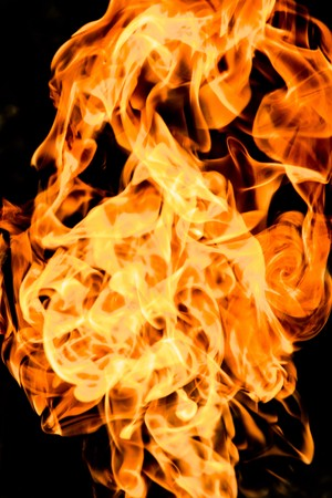 flammable: Fire flames on a black background Stock Photo