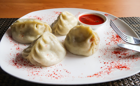 Dough with steamed meat, manti Stock Photo